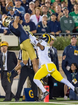 Notre Dame's William Fuller hauls in a touchdown pass late in the first half.
