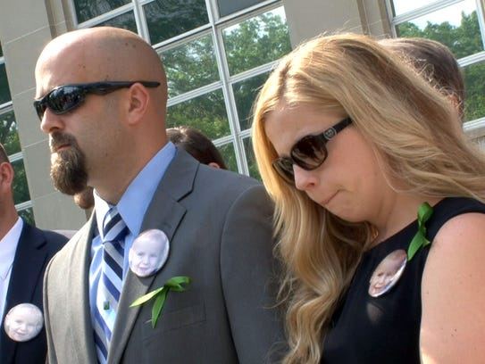 Mason Hess' parents Adam and Kellie Hess are shown