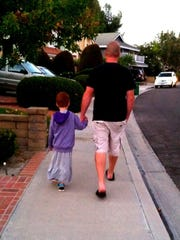 C.J. Duron and his dad, Matt, a police officer, out for an evening walk.