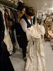Sandi Larson with an authentic dresses that are part of her Antique Clothing Museum in Lemmon Valley.