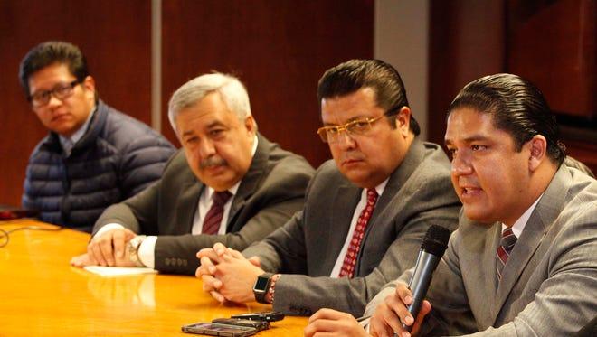 Former Juárez Police Chief Jorge Enrique González Nicolás, second from left, Juárez Mayor Armando Cabada, third from left, and interim Juárez Police Chief Sergio Amaraz Ortiz, right, are shown at a news conference.
