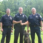 From left: Lt. Richard Wilson, Officer John Williams, Ace, and Capt. Thomas Pape.