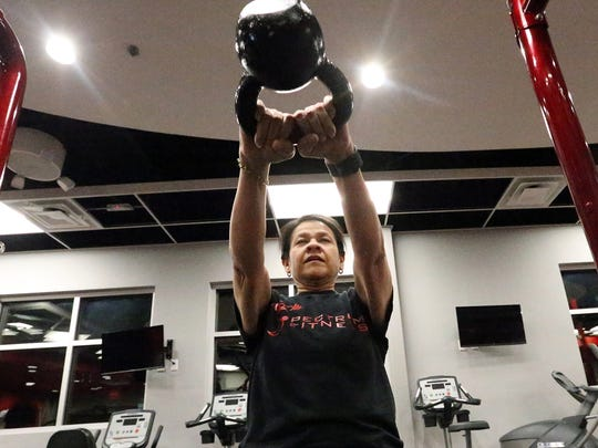 Melissa Ontiveros-Chavez swings a kettle weight while training to run a half marathon.