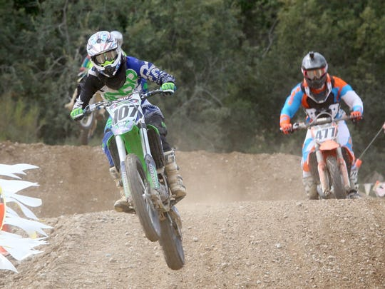 Mason Reeves, of McCleary, flies over a jump during a race at MotoWest park in Bremerton in August 2016. Motocross racing returns to the park this weekend.