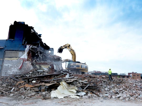 Crews bring down the former milk processing plant on
