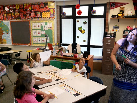 Armin Jahr Elementary School first-grade teacher Ashleigh Schiano-Oliver laughs after she tricked the class on the starting time question for a math quiz.