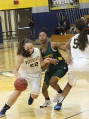 Northeast's Sepe Moore (22) looks for room around a