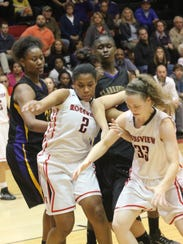 Rossview's Samajia Ogburn (2) and Liz Quinio (33) battle