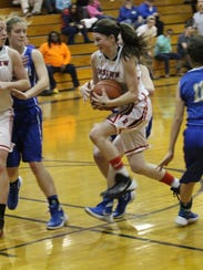 Rossview's Macy Rippy looks for room to drive to the