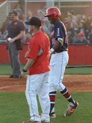 Rossview coach Parker Holman shares a laugh with left