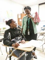 Student Deayanna Morton, left, talks with teacher-mentor