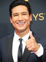 Mario Lopez arrives on the red carpet during 68th Emmy