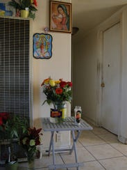 A small shrine of flowers and candles marks where Marlon Joel Rodas-Sanchez died.