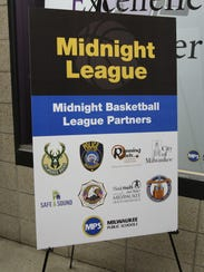 A poster promoting the Midnight Basketball  League