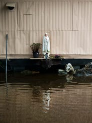 Water floods the streets of a trailer park off Oakland