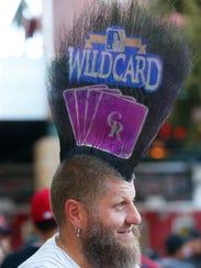 Colorado Rockies fan Josh Pugh, of Denver, CO., is
