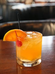A rhubarb old fashioned cocktail is a spring favorite