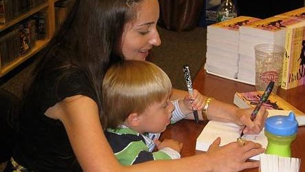"When he was younger, Jack helped his mom sign copies of her book ""Rattled!"""