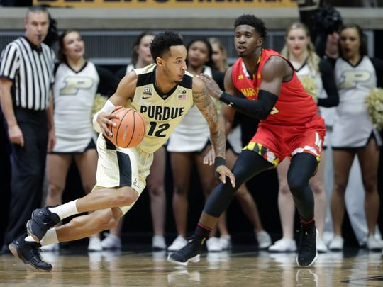 Purdue forward Vincent Edwards (12) drives on Maryland