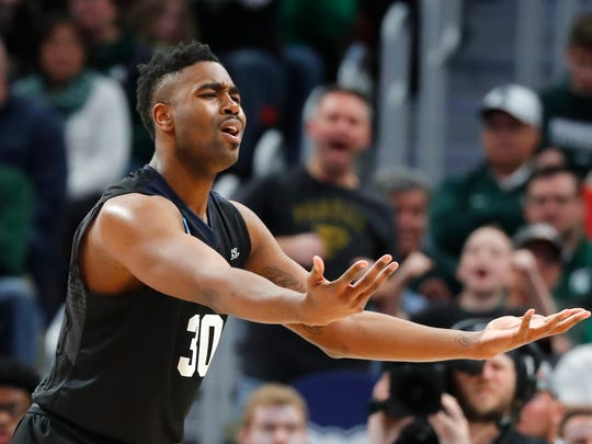 Butler forward Kelan Martin (30) argues a call during the second half of an NCAA men's college basketball tournament second-round game against Purdue in Detroit, Sunday, March 18, 2018.
