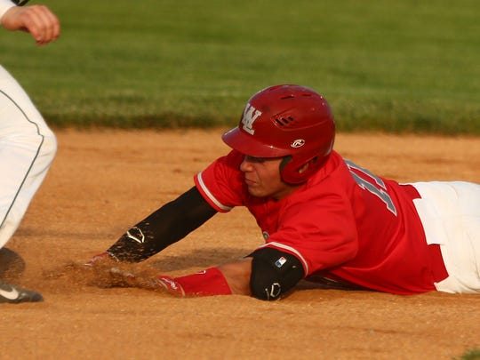 West Lafayette's Spencer Ronchetto slides into second