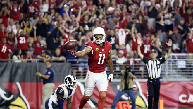 Arizona Cardinals Larry Fitzgerald makes a touchdown catch against the Los Angeles Rams in the first half on Dec. 3, 2017 at University of Phoenix Stadium in Glendale, Ariz.