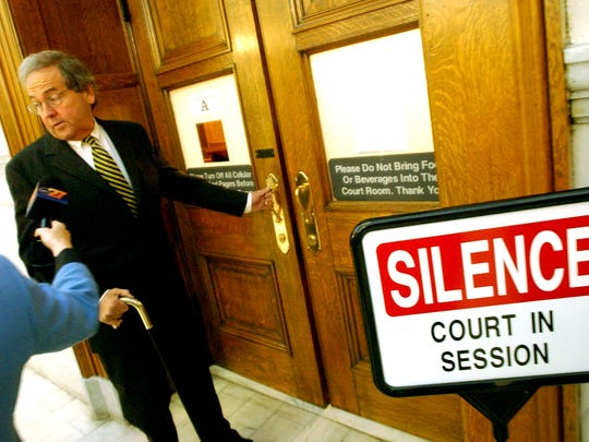 Then-York County District Attorney Stan Rebert pauses to answer questions before entering court room A at the Montgomery County court house for jury selection in this 2003 file photo.