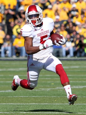 Oct 11, 2014; Iowa City, IA, USA; Indiana Hoosiers wide receiver J-Shun Harris II (5) rushes the ball against the Iowa Hawkeyes at Kinnick Stadium. Mandatory Credit: Reese Strickland-USA TODAY Sports