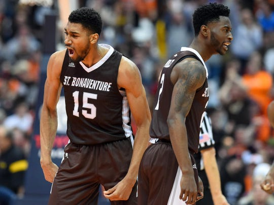 St. Bonaventure's LaDarien Griffin (15) and Matt Mobley (2) react to a play against Syracuse.