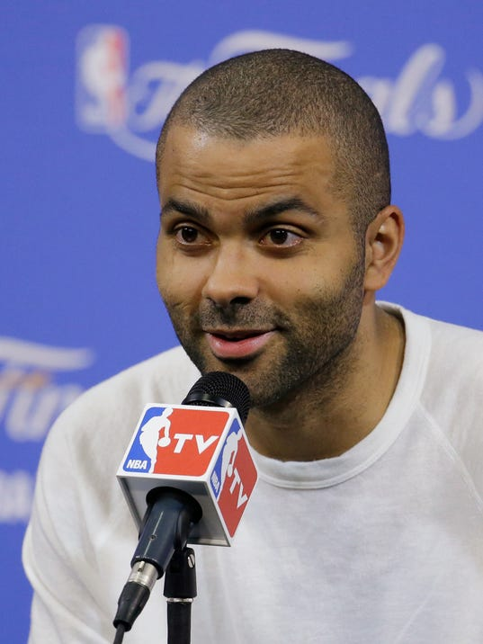 San Antonio Spurs guard Tony Parker speaks during a post-game news conference after Game 4 of the NBA basketball finals,  Friday, June 13, 2014, in Miami. The San Antonio Spurs defeated the Miami Heat 107-86. (AP Photo/Wilfredo Lee)