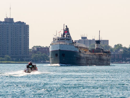 A U.S. Coast Guard boat approaches a freighter on the
