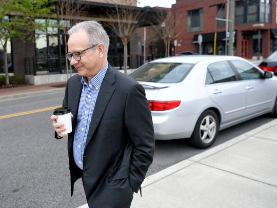 Nashville Mayor David Briley walks to work from his home to his office at Public Square on April 6.