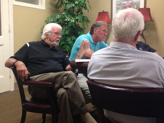 Madison County Commission Chairman Gary Deaton, left,