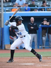 Angel Perez stands up at bat during the opening game at Dutchess Stadium.