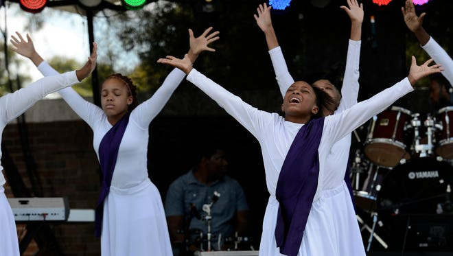 Antionette Chambers, right, and the Madison Community Center Praise Dancers perform during the African Street Festival at Hadley Park on Sunday in Nashville.