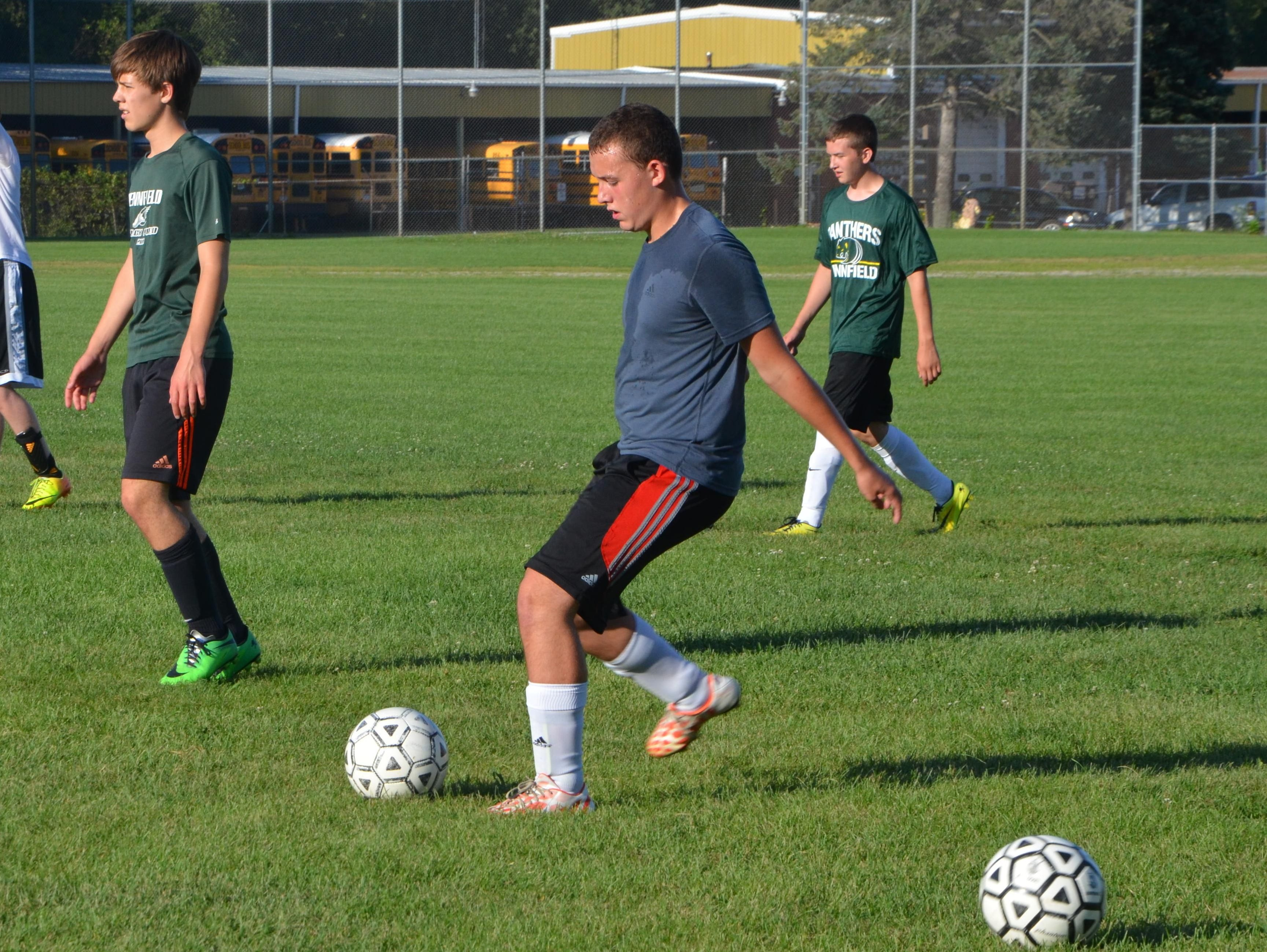 Pennfield's Archie Smith kicks the ball for a drill during the first practice of the season on Wednesday.