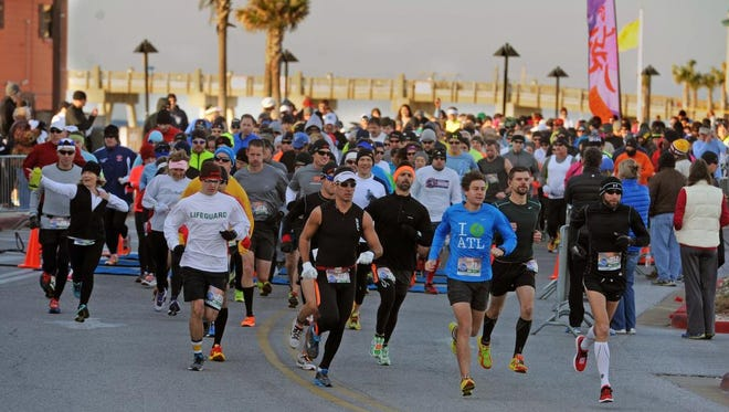 Runners break from the starting line during a previous Pensacola Beach Half Marathon. This year's event will be held Saturday, Jan. 13, 2018.