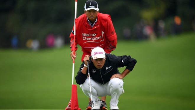 Hideki Matsuyama of Japan lines up a putt on the 18th green during the third round at the World Golf Championships-HSBC Champions golf tournament in Shanghai on October 29, 2016. / AFP PHOTO / JOHANNES EISELEJOHANNES EISELE/AFP/Getty Images ORIG FILE ID: AFP_HL6P4