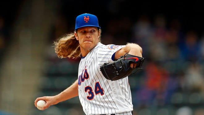 New York Mets starting pitcher Noah Syndergaard delivers a pitch during the first inning of a baseball game against the Colorado Rockies on Sunday, May 6, 2018, in New York. (AP Photo/Adam Hunger)