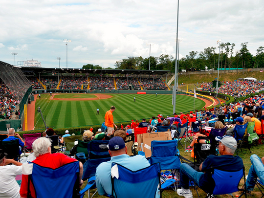 Little League fans watch the final outs of an international elimination game between Japan and Venezuela on Lamade hill. The hill is likely to be even more crowded on Saturday for Red Land's U.S. championship. (Chris Dunn - York Daily Record)