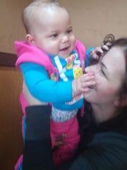 Alma Kajtazovic plays with her granddaughter, Amiya,