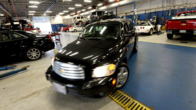 A Chevrolet HHR vehicle is pulled into a service bay before having a new ignition switch installed during a recall repair at Fitzgerald Auto Mall in Frederick, Maryland.