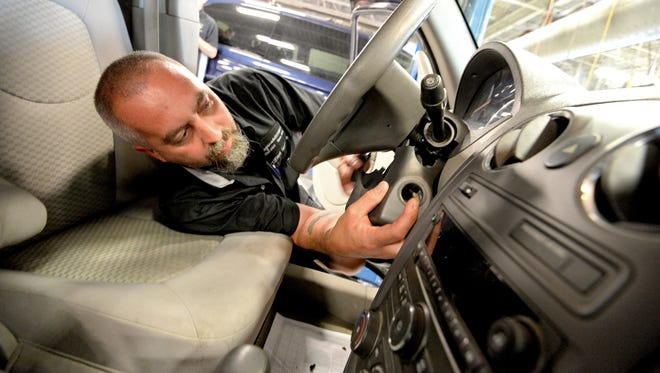 Technician Billy Morgan installs a new ignition switch during recall repair on a Chevrolet HHR at Fitzgerald Auto Mall in Frederick, Md. GM's website is wrongly telling some owners their cars aren't included, when they are, but repair parts aren't yet available.