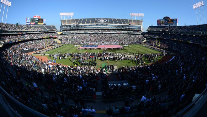 General view of O.co Coliseum during the national anthem before the game between the Oakland Raiders and the Tennessee Titans.