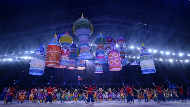 Large helium inflatables create the elements of St. Basil's Cathedral during the opening ceremony for the Sochi 2014 Olympic Winter Games at Fisht Olympic Stadium.