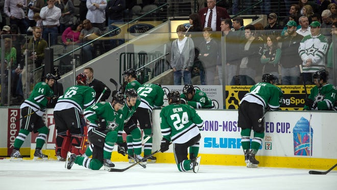 Play is stopped during the Dallas Stars and Columbus Blue Jackets game while team officials check out center Rich Peverley.
