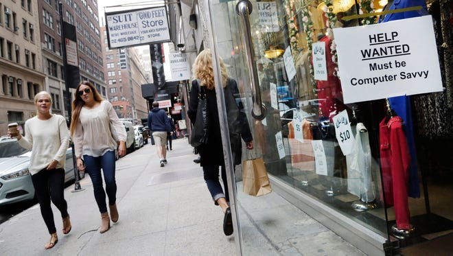 """In this Thursday, Oct. 1, 2015, photo, a """"Help Wanted"""" sign hangs in a store window in New York. U.S. employers added a robust 242,000 workers in February 2016 as retailers, restaurants and health care providers drove another solid month for the resilient American job market. The Labor Department says the unemployment rate held steady at 4.9 percent."""