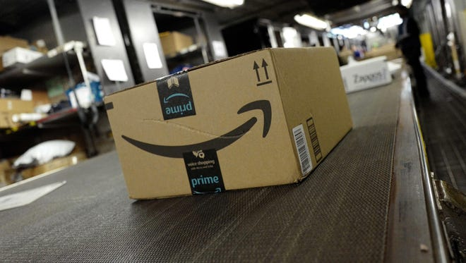 A package from Amazon Prime moves on a conveyor belt at a UPS facility in New York.
