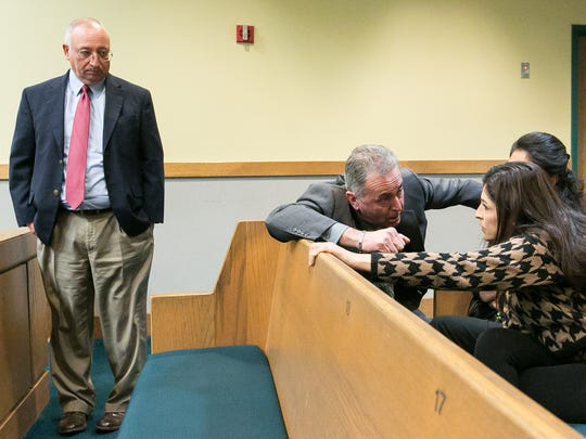 Doña Ana County District Attorney Mark D'Antonio speaks with embezzlement victim Maribel Samaniego on Friday in 3rd Judicial District Court during sentencing for former El Paso County Judge Anthony Cobos, while prosecutor Jose Arguello, left, stands nearby.