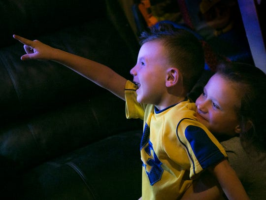 Cole Thompson, 4; watches a cartoon with his sister,